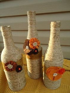 Diy twine and fabric flowers wine bottle crafts - table decoration, wedding centerpieces (Decorated Bottle With Twine) Thanksgiving Crafts, Fall Crafts, Holiday Crafts, Diy And Crafts, Simple Crafts, Holiday Decor, Wine Bottle Art, Diy Bottle, Wine Bottle Crafts