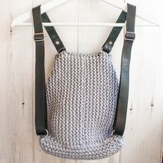 Knitted backpack made from 100% cotton yarn with leather handles