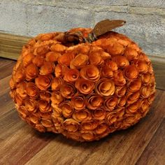 How sweet is this wood curl pumpkin? Hmmm.... Could be done with different types of paper?