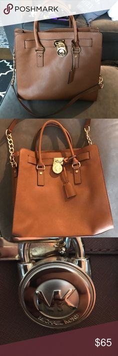 Michael Kors Camel and Gold Purse Michael Kors Purse- Camel and Gold- EUC- Some small spots on interior that could possibly be spot cleaned. Comes with attached MK key to unlock MK lock. Chains and long strap attached in very good condition- Bottom of bag and feet have very minimal wear. Smoke Free home MICHAEL Michael Kors Bags Shoulder Bags