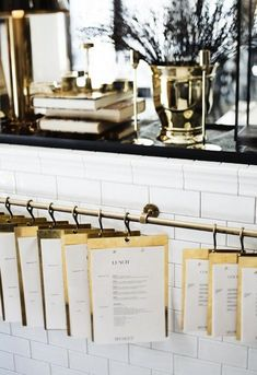 Gold menus and cafe style. White and gold interior inspiration. #wildandgrizzly #whiteandgold