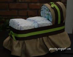 tutorial on Homemade Baby Shower diaper carriages Centerpieces   DIY Diaper Cradle ~ Rock-a-bye baby on the tree top! If you can ...
