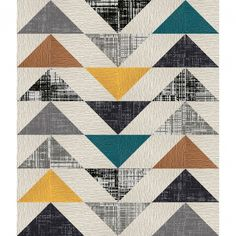 This area rug features Made You Look in Bone, Turquoise, Marigold, Copper, Tuxedo Pocket in Black, Grey, Dappled Daylight in Black and Titanium.  This area rug contains diagonal cut tiles.  To assemble your rug, just use the FLORdots in the box with your squares.