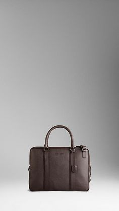 Textured leather crossbody briefcase with protective padding in brown by Burberry