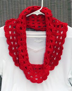 Lacy Crimson Cowl - Just in time for the fall season you can work up this beautifully lacy crocheted cowl. Keep cozy while taking a crisp fall walk or sitting in a chilly office space.