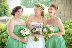 Purple, green, and white bridal party bouquets.