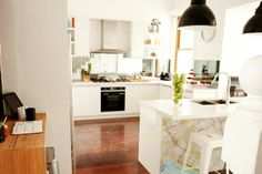 Love this kitchen from The Block. Bright and light and awesome lights! Love the little wood desk at the side too :)