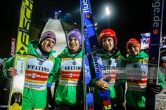 Severin Freund, Andreas Wellinger, Andreas Wank and Richard Freitag from Germany pose for photographers as they won the team competition during the FIS World Cup Ski Jumping day two on November 21, 2015 in Klingenthal, Germany.