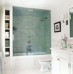 Traditional White Bathroom with CLassic Vanity and White Bathtub Shower Combination and Wall Mounted Shelves and Subway Ceramic Flooring - Use J/K to navigate to previous and next images