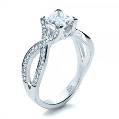 Custom Princess Cut Engagement Ring -- I'm not one to pin these sorts of things, but this is gorgeous.