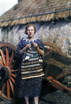 Ireland, 1920s - a young girl knits a wool garment.  (photograph by Clifton R. Adams, © National Geographic)