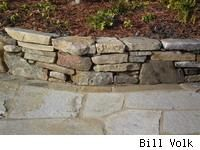 How to build natural stone walls:    This post is the first of five on retaining walls and their construction, beginning with the easiest -- gravity-stacked stone walls -- and working through, in ascending order of construction difficulty, pressure-treated timbers, engineered materials, mortared rock, and cultured stone; the last not truly a wall type, but a wall facing.
