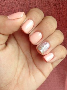Pastel pink gel nail polish with a silver glitter accent nail