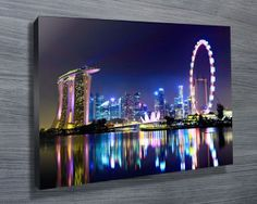 SINGAPORE CITY SKYLINE $26.00–$741.00 This is a beautiful print of the Singapore city skyline at night, as with all of our artworks, its avaiable as standard as a stretched canvas print, archival paper print or rolled canvas.#Stretchedcanvasprints  #Canvasphotos