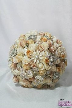 Another #gorgeous #mixedmedia #bouquet.  These #alternative #bouquets are designed to replaced your traditional fresh #flowers that you would normally carry on your #weddingday  - They are a #beautiful #keepsake that you can #treasure for years and have as a #memory of your #wedingday  #custommade #broochbouquets #weddingday #unique #alternative #cream #champagne #ivory  www.nicsbuttonbuds.com.au www.facebook.com/nicsbuttonbuds www.pinterest.com/nicsbuttonbuds…