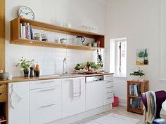 kitchen white tiles white cabinets white floors open wood shelf