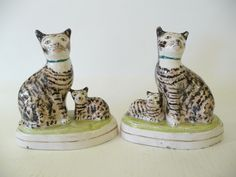 Seated Cats and Kittens. Black, Tan & White Striped Tabby Cat & Kitten on Base. Staffordshire, England. Circa 19th Century. 18cm.