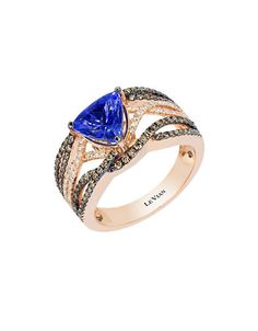 A radiant blueberry tanzanite stone adorns this gorgeous 14k strawberry gold ring.