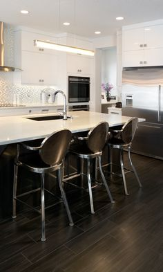 Customer home in New Brighton with some great upgrades, including stainless steel appliances, a sleek chimney style hood fan and a beautiful full tile blacksplash. Calgary News, Morrison Homes, Hood Fan, New Brighton, Luxury Estate, Stainless Steel Appliances, Home Builders, Townhouse, Home Improvement