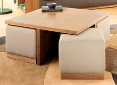 I've always wanted one of these..Clever use of space, walnut coffee table with linen stools Dwell £249