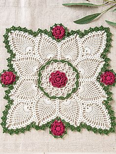 crochet doilies The doily is accented with a border of dimensional roses, bringing crochet motifs and pineapples together in perfect style. Made using Lizbeth size 10 crochet cotton th Crochet World, Annie's Crochet, Crochet Dollies, Thread Crochet, Crochet Crafts, Crochet Hooks, Crochet Projects, Filet Crochet, Irish Crochet Patterns