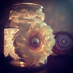 another homemade christmas gift i just finished! a tea candle in a glass jar, surrounded by lace, jewels, and a flowered pearl, with quilted cloth jeweled flowers on the wooden lid!