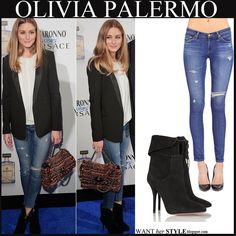 Olivia Palermo in blue skinny distressed AG jeans with black suede ankle boots. Love the boots!