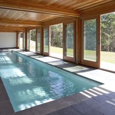 I want a pool partially under our lake house. How cool would that be?!