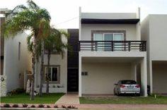 Fachadas de casas modernas: Fachada de casa moderna con cochera doble techada