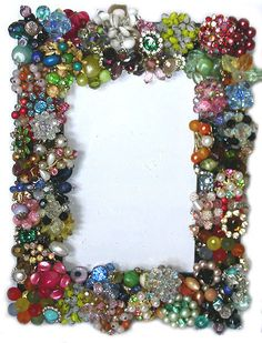 Frame covered in vintage jewelry made by my Mom. You can find more of her creations on her facebook page Mebbie's Vintage Jeweled Decorative Items. BTW...she does all of this work with 1 hand due to a stroke that left her right side paralyzed. She's amazing!