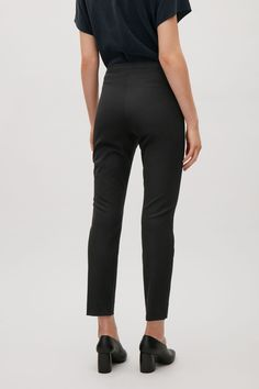COS image 3 of Slim trousers with grosgrain waist in Black