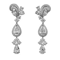 CARTIER. Earrings - platinum, pear-shaped diamonds, brilliant-cut diamonds. #Cartier #2010 #HauteJoaillerie #HighJewellery #FineJewelry #Diamond