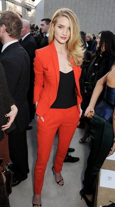 Red trouser suit and black top at Burberry Prorsum.