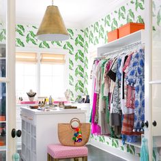 A bright, light & airy walk-in closet w/ plenty of whites & bold banana leaf wall paper. Open display for dresses. Island cabinet for accessories. Master Closet, Walk In Closet, Closet Space, Master Bathroom, Bamboo Blinds, Unique Wallpaper, Print Wallpaper, Faux Bamboo, Stores