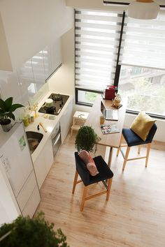 Transforming a poorly planned and tiny apartment in New Taipei City, Taiwan, A Lentil Design crafted this fabulous little space for a modern, urban couple