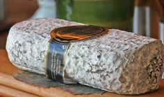 Montenebro (MON-teh-NEY-bro) is an unusual Spanish goat cheese made by Rafael Baez and his daughter Paloma in Avila, west of Madrid. Shaped like a flattened log, it has a mottled brownish-gray rind with a covering of Penicillium roqueforti mold. The paste is bone white and as it ages it gradually softens under the rind providing a smooth creaminess. The flavor is as complex as a goat cheese can be with tangy, rich and lingering pepper undertones. cheese