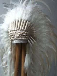 I love this for a true boho bride...definitely a statement piece! Cowrie Shell All White Long Full Feather Headdress - Made To Order. via Etsy.