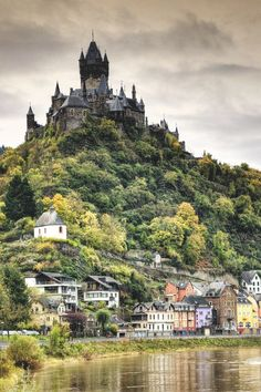 Cochem Castle which stands on a hill 100 metres above the River Mosel ...