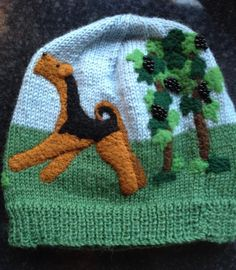 Airedale in the grapevines, needle felted hat. Sandra Pounder Designs
