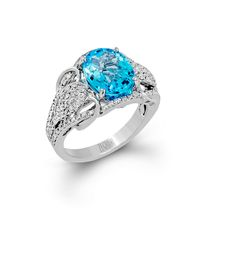 This stunning ring from our Blindingly Beautiful collection features a 4.04 ct blue topaz in 14 white gold set with .62 ctw of white diamonds.
