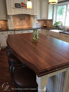 Sapwood Kitchen Island Top with a Conventional Double Roman Ogee on the Top Horizontal Edges, 1/8″ Roundover on the Bottom Horizontal Edges and Vertical Corners and a Durata® Finish in Matte Sheen. https://www.glumber.com/image-library/custom-walnut-kitchen-island-countertop-columbia-maryland/