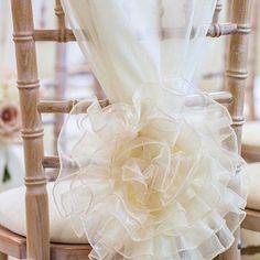 Elegant and sophisticated ✨ is @debonairvenuestyling's bespoke chair flowers. Photo: @karenmasseyphotography