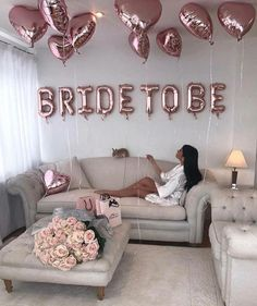 BRIDE TO BE letter balloons and hearts in rose gold