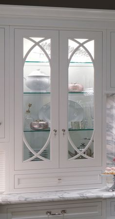 I'd really like wavy glass upper cabinet doors with glass adjustable shelves, stay cool lighting and leaded glass doors!!