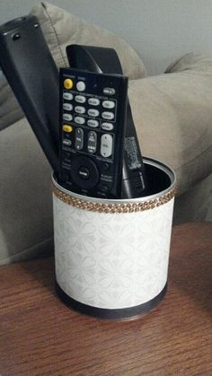 baby formula can (find coffee can) + scrapbook paper + embellishments = remote holder! Baby Formula Containers, Baby Formula Cans, Tin Can Crafts, Diy And Crafts, Formula Can Crafts, Pots, Baby Food Jars, Milk Cans, Recycled Crafts