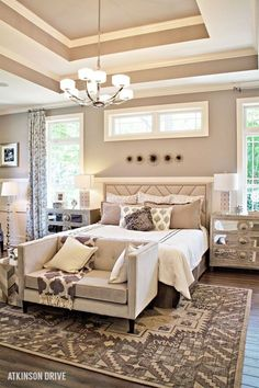 Dreaming of a luxurious master bedroom? Create your own relaxing retreat with a few furniture staples: a stately bed, stunning side tables, a chic bench at the foot of the bed, a dazzling area rug, and beautiful d/u00e9cor accents.