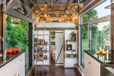 On the other side of the house, there's a lofted bedroom above the bathroom.