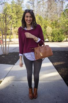 Shop this look on Lookastic: http://lookastic.com/women/looks/skinny-jeans-watch-ankle-boots-long-sleeve-blouse-crew-neck-sweater-tote-bag/8203 — Charcoal Skinny Jeans — Gold Watch — Brown Leather Ankle Boots — White and Black Horizontal Striped Long Sleeve Blouse — Burgundy Crew-neck Sweater — Brown Leather Tote Bag