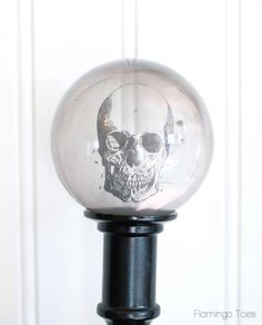 """Holy moly, we are soooo doing this for Halloween. Find cheap candlesticks at garage sales, or use the 40% off Hobby Lobby coupon and buy them that way if they're not on sale, use glass ornaments and her method for """"smoke-ifying"""" them, print creepy image on transparency, marry them all together!"""