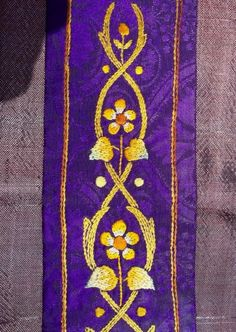 Purple stole: detail of hand embroidery